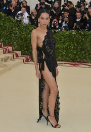 Zoe Kravitz went risque in a barely-there asymmetrical lace dress by Saint Laurent at the 2018 Met Gala.