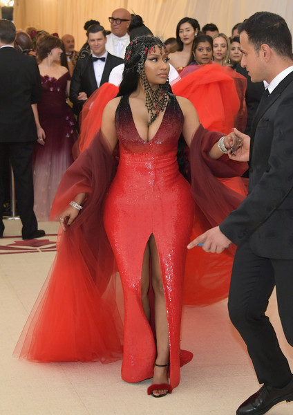 Nicki Minaj was all curves in a figure-hugging red sequin gown by Oscar de la Renta at the 2018 Met Gala.