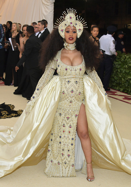 Cardi B looked flamboyant in an ornately beaded Moschino gown with a voluminous train at the 2018 Met Gala.