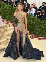 Gigi Hadid looked downright fab in a stained glass-inspired one-shoulder gown by Versace at the 2018 Met Gala.