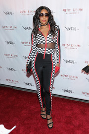 Gabrielle Union teamed her catsuit with strappy black heels.
