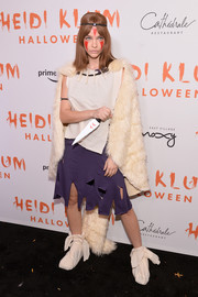 Barbara Palvin attended Heidi Klum's Halloween party dressed as San from 'Princess Mononoke.' For the upper half of her outfit, she donned a simple sleeveless white top.