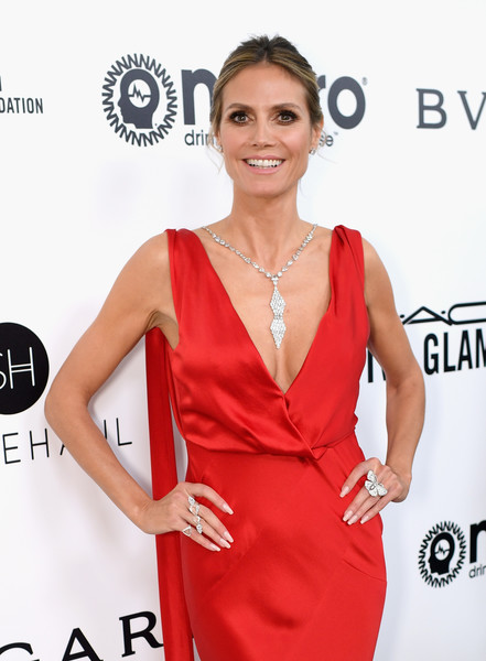 Heidi Klum Butterfly Ring [red carpet,clothing,dress,red,red carpet,shoulder,cocktail dress,fashion model,carpet,premiere,neck,heidi klum,west hollywood park,california,the city,elton john aids foundation,oscar viewing party,academy awards viewing party]