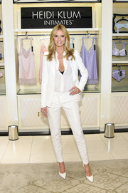 Heidi Klum looked very polished in a crisp white pantsuit during the launch of her lingerie collection.