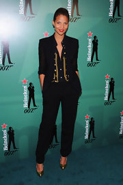 Denise Vasi teamed up her blazer with a pair of boyfriend trousers.