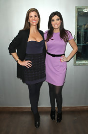 Kimberly Guilfoyle complemented her simple lavender dress with fierce black patent ankle boots at the Helen Yarmak fashion show.