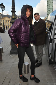 Helena stays warm in Paris in this purple zip up down jacket.