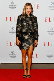 Lauryn Eagle chose a gold and black printed zip-up jacket and matching skirt for her cool and contemporary red carpet look.