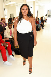 For her bag, Paloma Elsesser chose a simple black patent purse.