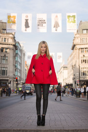 A chic red cape was the main player in Laura Whitmore's outfit at the opening of Oxford Street's Fashion Showcase.