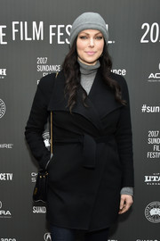 Laura Prepon bundled up in a black wide-lapel coat for the Sundance premiere of 'The Hero.'