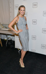 Petra Nemcova poured herself into a sexy yet tasteful gray bandage dress for the Herve Leger fashion show.
