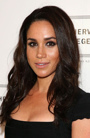 Meghan Markle sported chic piecey waves at the Herve Leger by Max Azria fashion show.