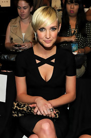 Ashlee Simpson Wentz wore her golden tresses sleek and side-swept at the Herve Leger by Max Azria Spring 2012 fashion show. She created a deep side part then brushed her bangs forward and off to the side.