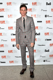 Eddie Redmayne looked cool and quirky in a plaid suit at the 2011 Toronto Film Festival.
