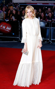 Sienna Miller complemented her gown with an elegant beaded box clutch.