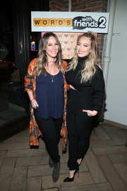 Hilary Duff sealed off her all-black attire with a pair of patent pumps.