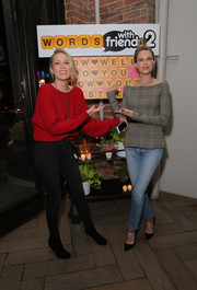Sara Foster bundled up in a loose red sweater for the launch of Words with Friends 2.
