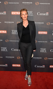 Connie Nielsen opted for a simple charcoal pantsuit teamed with a V-neck tee when she attended the White House Correspondents' Dinner Weekend celebration.