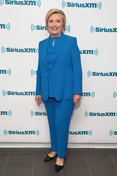 Hillary Clinton visited SiriusXM wearing an all-blue jacket, top, and pants ensemble.
