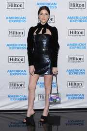 An iridescent chain-strap bag by Balmain sealed off Anna Kendrick's look.