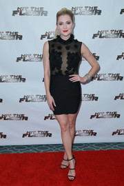 Katherine Bailess complemented her dress with black triple-strap sandals.