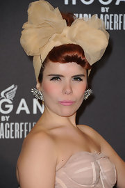 Paloma loves to wear dramatic hair accessories and did so at the Karl Largerfeld Cocktail party in Paris.