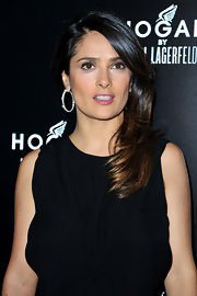 Salma Hayek attended the Hogan by Karl Lagerfeld fall 2012 runway show wearing her glossy hair in a casually side-swept.
