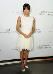 Eva Longoria was demure in a white Philosphy dress with a pleated skirt during the Q&A with Ann Curry event.