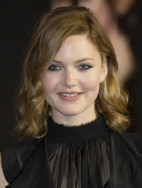Holliday Grainger Medium Curls [my cousin rachel,film,photo,hair,face,blond,hairstyle,eyebrow,beauty,chin,lady,lip,smile,red carpet arrivals,rachel,holliday grainger,british,world premiere,arrival,world premiere]