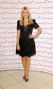 Holly Willougby's LBD had a bit of an edge to it with its lace sleeves and embroidered detailing on the bodice.