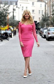 Holly Willoughby stunned in this pink frock, which featured long lace sleeves and a fitted skirt.