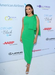 Eva Longoria donned a fitted green dress with a bowed shoulder for the 2019 DesignCare Gala.