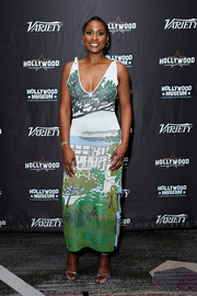 Issa Rae finished off her look with a pair of silver ankle-strap sandals.