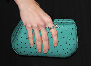 AnnaLynne's turquoise clutch was super eye-catching and was still simple enough to let her elegant dress shine.