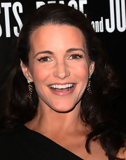 Kristin Davis looked natural but elegant at the Hollywood Domino and Bovet 1822 Gala with gold leaf dangling earrings.