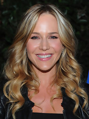Julie Benz wore her blond locks in long spiral curls at the premiere of 'Answers To Nothing.'