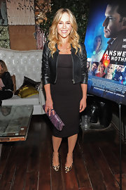 Julie Benz rocked a cropped and collarless leather jacket over a fitted LBD at the premiere of 'Answers to Nothing.'