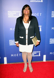Chaz Ebert completed her ensemble with a metallic gold snakeskin clutch.