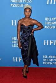 Cynthia Erivo showed off her toned shoulders and arms in a strapless two-tone dress by Michael Kors at the HFPA Grants Banquet.