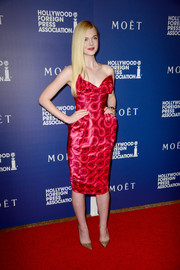 Elle Fanning completed her flawlessly chic red carpet look with sparkly gold Louboutin pumps.