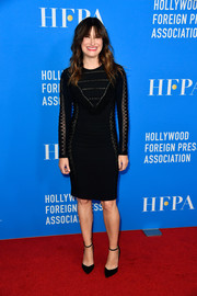 Kathryn Hahn complemented her dress with black ankle-strap pumps.