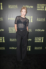 Leah Pipes opted for a black mesh top and wide-leg pants for her Golden Globe Award season celebration look.