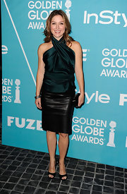 Sasha Alexander gave her silky halter an edge with the addition of a black leather pencil skirt.