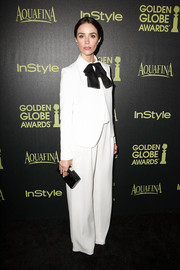 Abigail Spencer topped off her look with a stylish black box clutch.