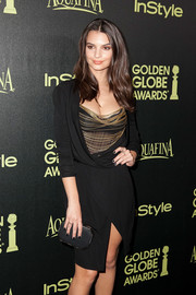 Emily Ratajkowski paired a classic black Amanda Pearl satin clutch with a sexy draped dress for the Golden Globe Award season celebration.