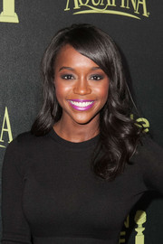 Aja Naomi King attended the Golden Globe Award season celebration wearing her hair in ultra-girly waves.