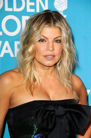 Fergie wore her layered haircut in casually tousled waves at A Night of Firsts presented by the Hollywood Foreign Press Association and 'InStyle.'