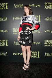 Lizzy Caplan exuded modern femininity in a Prabal Gurung floral crop-top worn over a matching mini dress during the Golden Globe Award season celebration.
