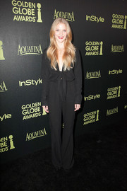 Winter Ave Zoli was '70s-chic in her long-sleeve black jumpsuit during the Golden Globe Award season celebration.